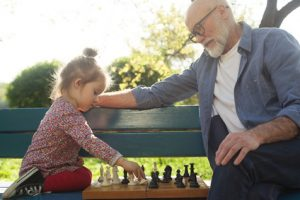 Grandfather and granddaughter spending time together